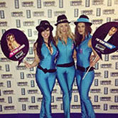 Three sexy brand ambassadors dressed in slinky blue outfits