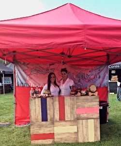 2 members of the event staff team working on a stand at a UK festival