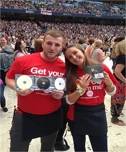 Two of our festival promotional event staff with promotional CD's for sale