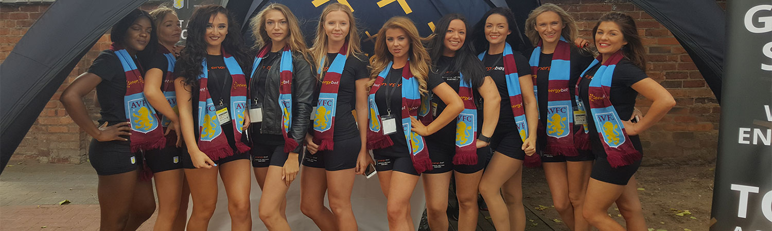 Line of promotional models dressed in sexy Aston Villa kit