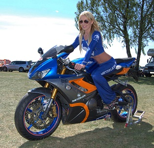 Attractive and sexy grid girl posing with one of the superbikes - available to hire from Pitlane Promotions